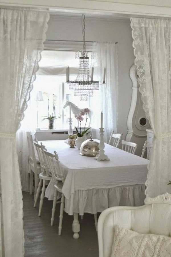Shabby chic dining room with lace curtains.