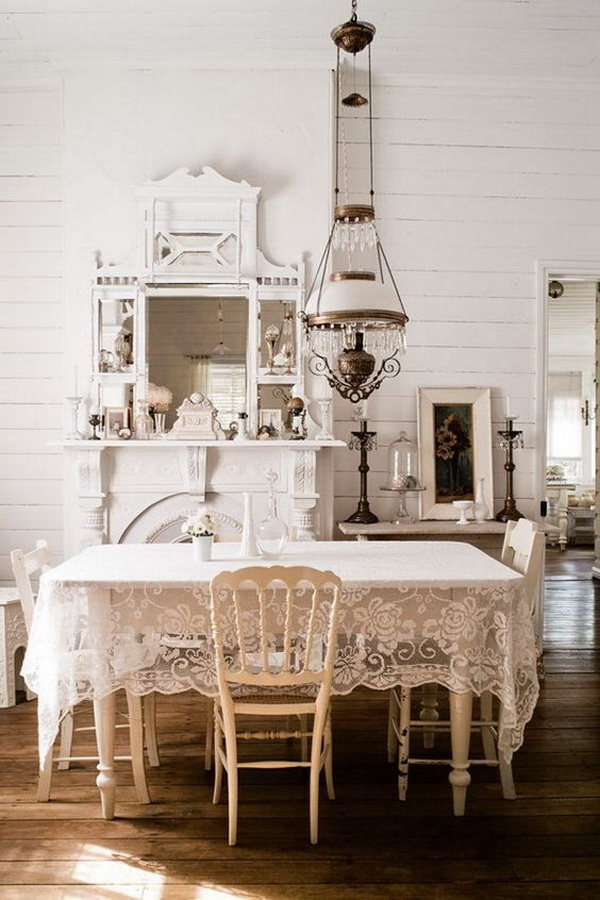 Shabby Chic Dining Room with Lace Table Cloth and Vintage Crystal Chandelier.