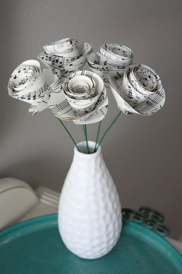 Large Paper Rose Flowers. These paper flower roses were handcrafted from repurposed sheet music or vintage old book pages.