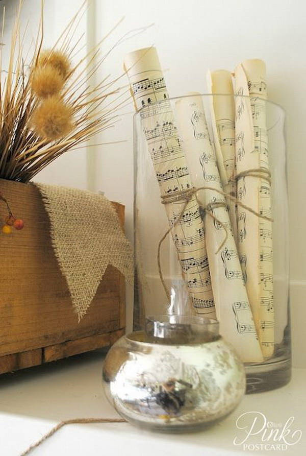 Hurricane Vase with Rolled Music Sheet. Rolled up sheet music,  tied with twin and placed in a vase, to create a unique home decor.