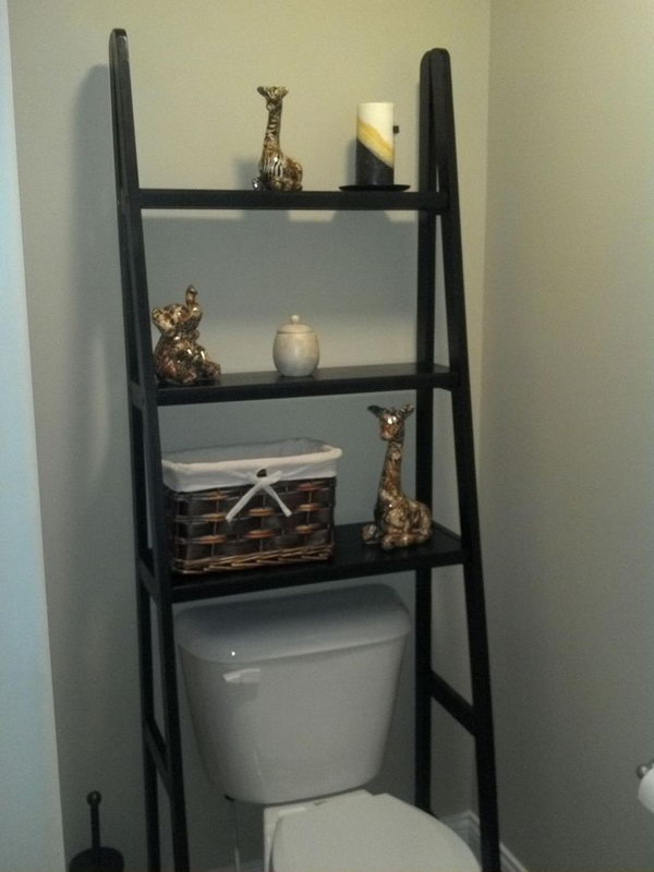 Repurposed Ladder Shelf Over the Toilet.