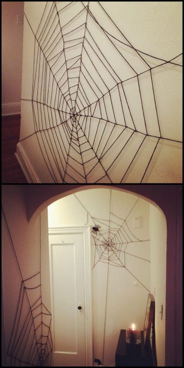 DIY Yarn Spiderweb. DIY very cheap and easy yarn spiderweb for the interior of your house or apartment decoration for this creepy season!
