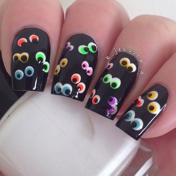 Black Halloween Nail Art with Colorful Eyes Designs.