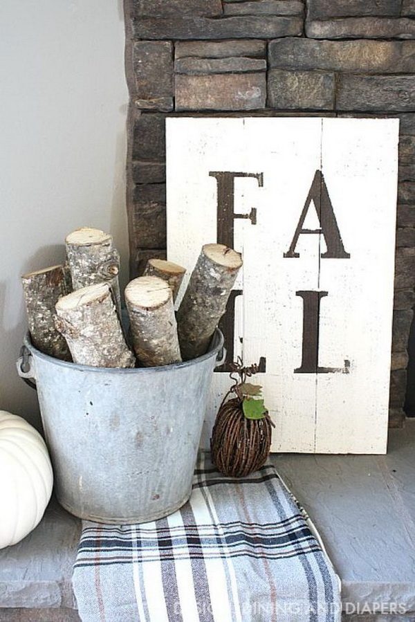 DIY Rustic Fall Sign. Gathering cut birch logs or branches of leaves in a container and creating a rustic palette inspired fall sign to create a beautiful vignette.
