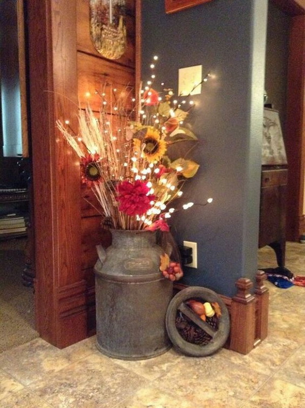 Rustic Fall Centerpiece for Front Porch. Love this fall decor! Arrange some fall natural elements, like sunflowers, wheat and branches into an old bucket and add some fairy lights.