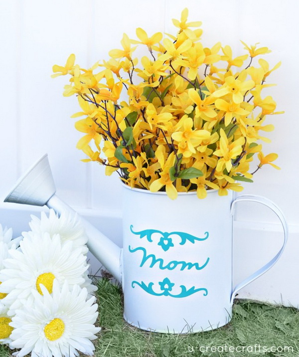"DIY Mothers Day Vase. Get a watering can and milk tin, spray painted it, and vinyled the words ""Mom"" and ""Grandma"" in their favorite colors and fill with fresh flowers! This will be a great gift for mom or grandmo who love to garden."
