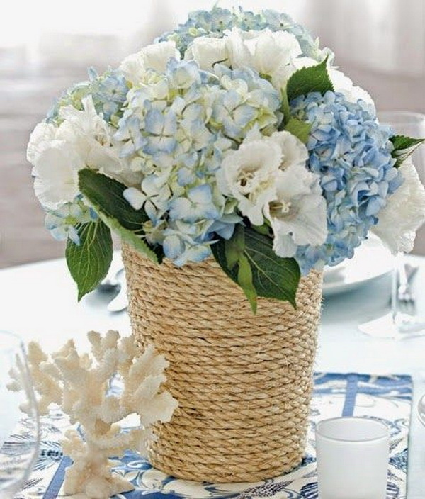 DIY Rope-Wrapped Vase. Transform the simple vase into a summer-themed centerpiece with just a few supplies in no time! It looks so pretty and has a seaside feel for your summer wedding decoration or any other outdoor theme.