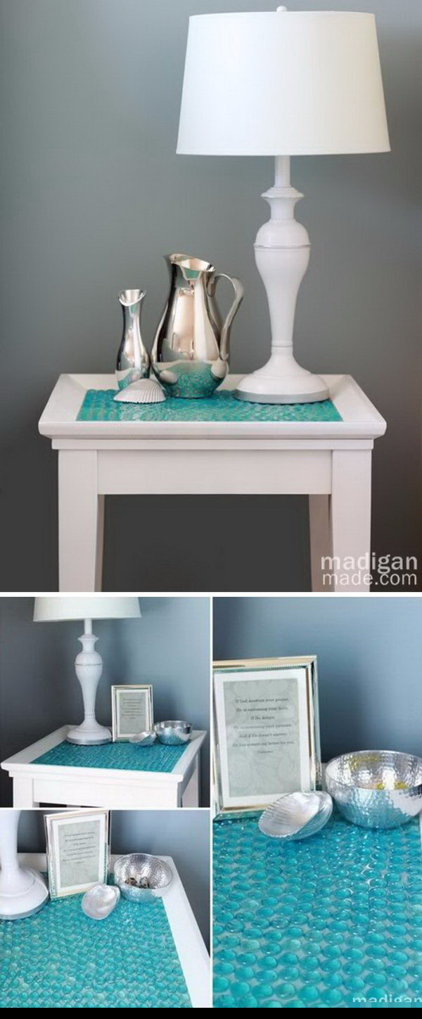 DIY Tile Table With Glass Gems. Turn a boring old side table into something beautiful and seemingly expensive with a package of glass gems or stones at the Dollar Store. It's also perfect for the beach home decor.