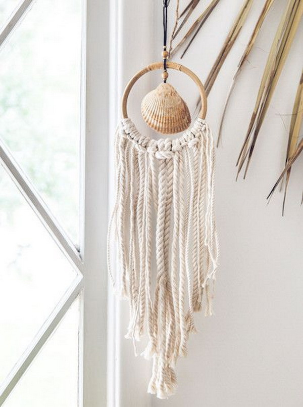 Beach Shack Wall Hanger. This gorgeous wall hanger is made with a beautiful sea shell at the center of a rattan hoop, adorned with chunky seaside style ropes! It creates a beach vibe to your decor during this summer. The supplies are also easy to find.