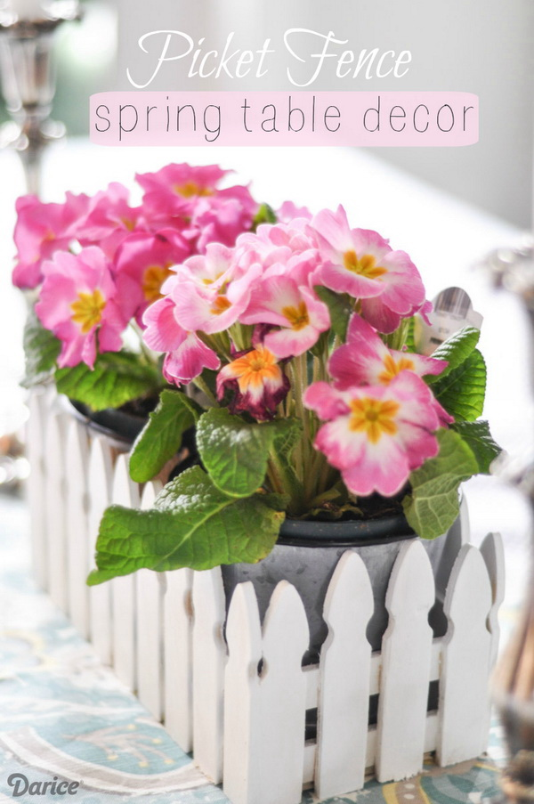 Spring Picket Fence Table Centerpiece. Create a darling centerpiece with unfinished picket fence container with just a few supplies! It is so easy to make in no time!