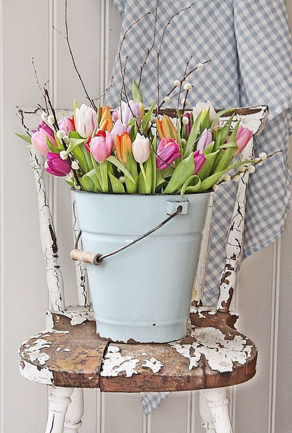 Metal Bucket Tulips Display. Display tulips in a chippy metal bucket! So simple and perfect for Spring and Easter decoration with a touch of shabby chic charm!