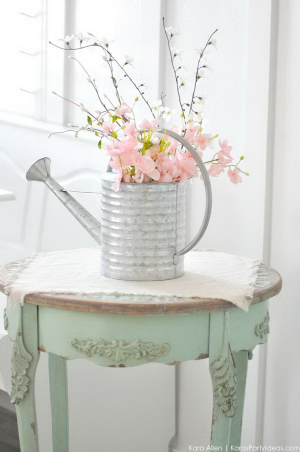 Spring Watering Can Floral Centerpiece. Create this beautiful spring centerpiece by upcycling an old watering canwith spring fresh flowers. Love how it easy to make and how it comes out for my spring home decoration!