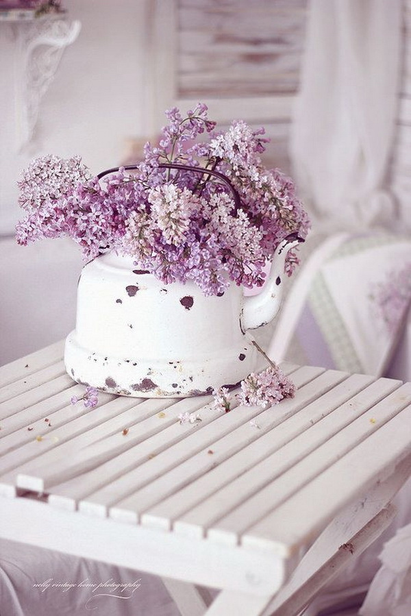 Purple Shabby Chic Look. Decorate with purple tones for a shabby-chic or comfortable cottage or country style. It is not very hard to do. Like putting a bunch of wild flowers in an old metal water jug for a simple but elegent decoration! It makes great centerpieces for your kitchen table, shabby chic weddings...