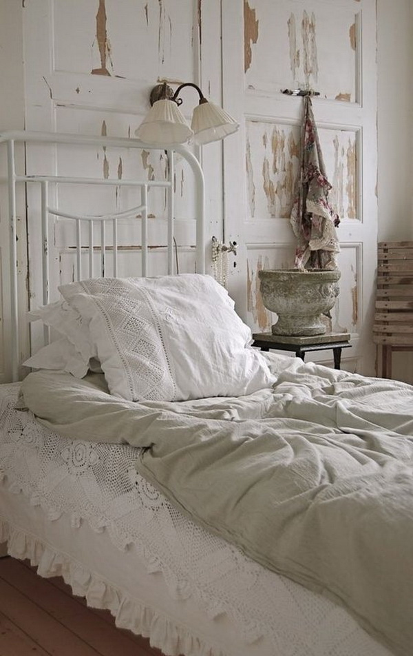 Shabby chic bedroom with antique door headboard.