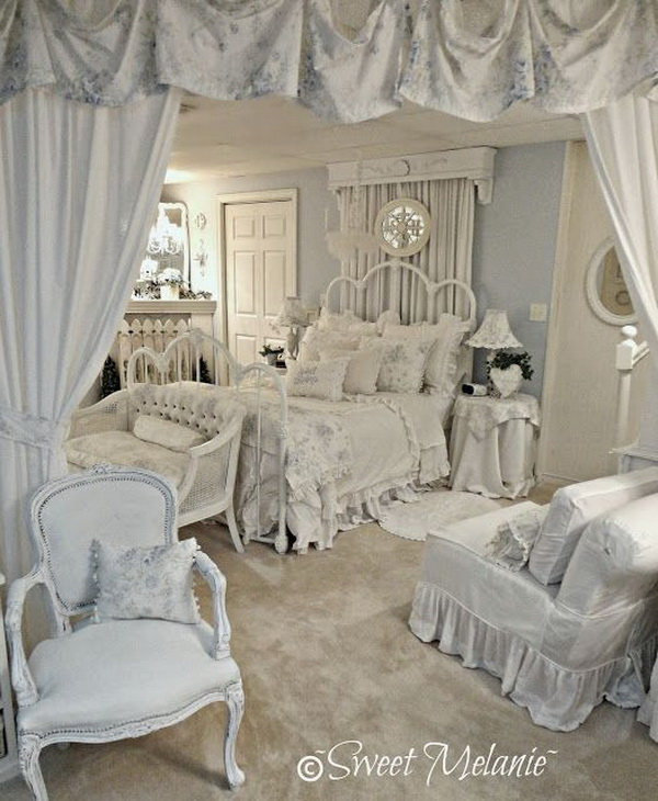 Gorgeously feminine bedroom decorated in the softest blue and white with hints of grey.