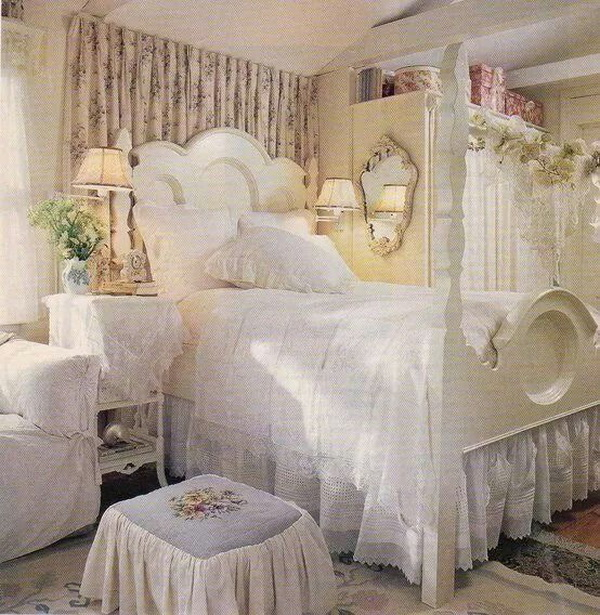 Shabby chic bedroom with floral prints beddings, vintage furniture.