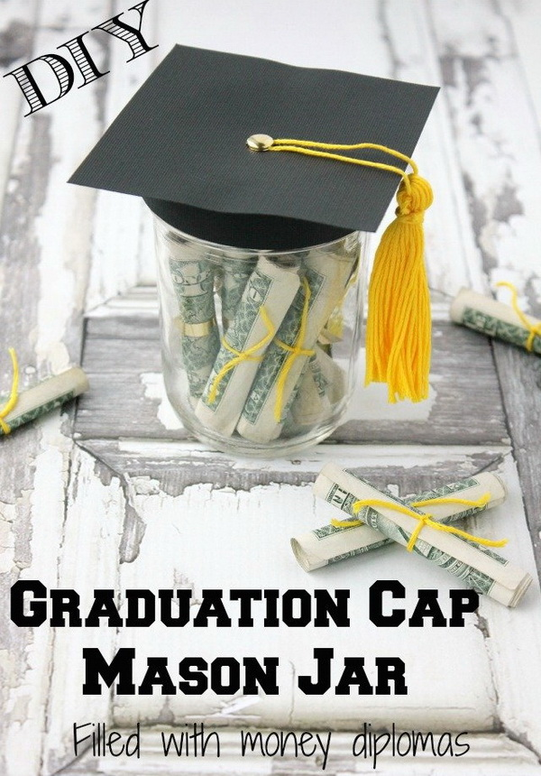 Graduation Cap Mason Jar Filled With Money Diplomas. A mason jar filled with dollar diplomas with a paper graduation cap with a tassel! This can not only be a cool graduation party decoration idea, but also a grea graduation money gift!