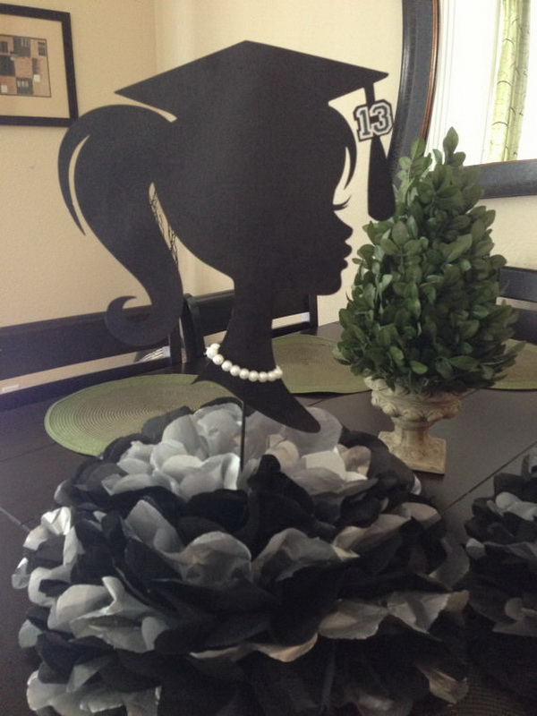 Graduation Decoration Centerpiece. A graduate girl silhouette and huge pom poms down below in single or double color combo as you like. It will catch everyone's attention with no doubt during your graduation party!