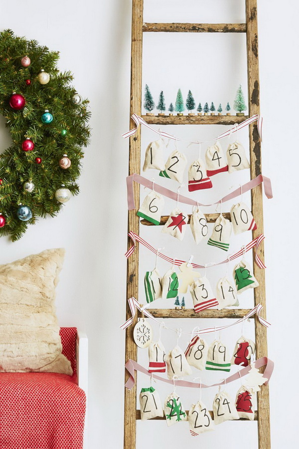 Ladder Advent Calendar Decorated with Muslin Craft Bags.