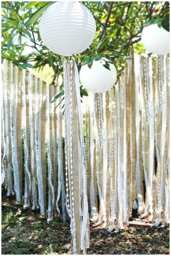 Vintage Wedding Backdrop Using Paper Lanterns and Ribbons.