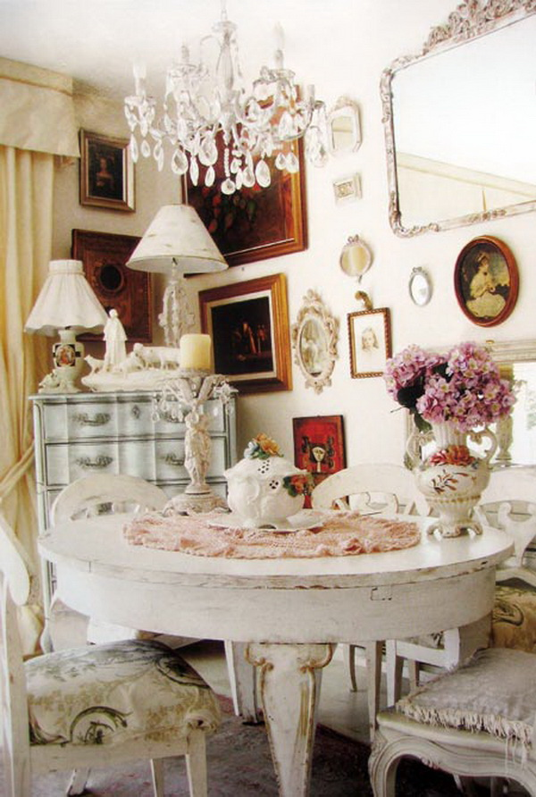 Shabby chic dining chair cushions and framed wall artworks.