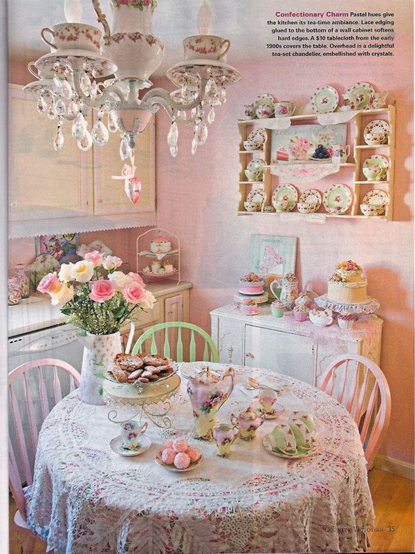 Small shabby pink dining area with dishware wall display and crystal chandelier.