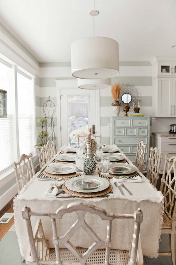Modern meets shabby chic in this elegant dining room. Rusic chairs, wooden tableware really add charm.