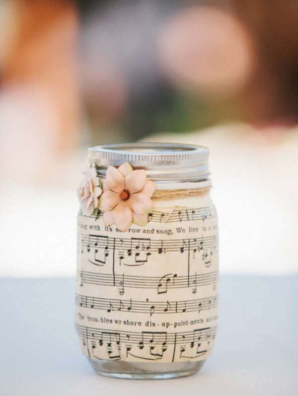 Sheet Music Covered DIY Mason Jar. Cover the mason jar with music sheets or old book pages for a vintage affair!