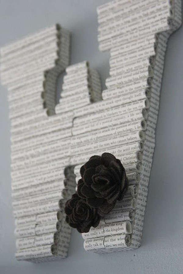 DIY Rolled Book Paper Letters. An elegant and unique decorative letter made with rolled book pages and finished with two cute fabric roses in dark brown.