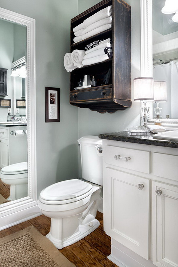 Dark Brown Cabinet above the Toilet for Extra Bathroom Space.