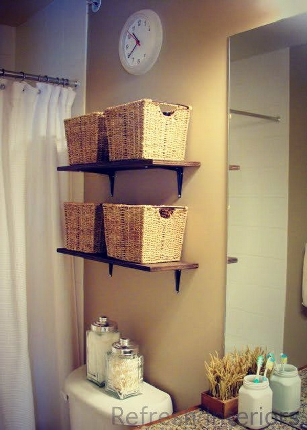 Above the Toilet Storage Idea with Wooden Shelves and Baskets.