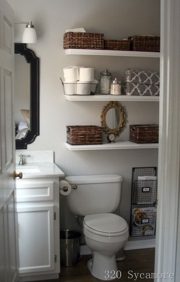 Open Floating Shelves over the Toilet for Bathroom Storage.