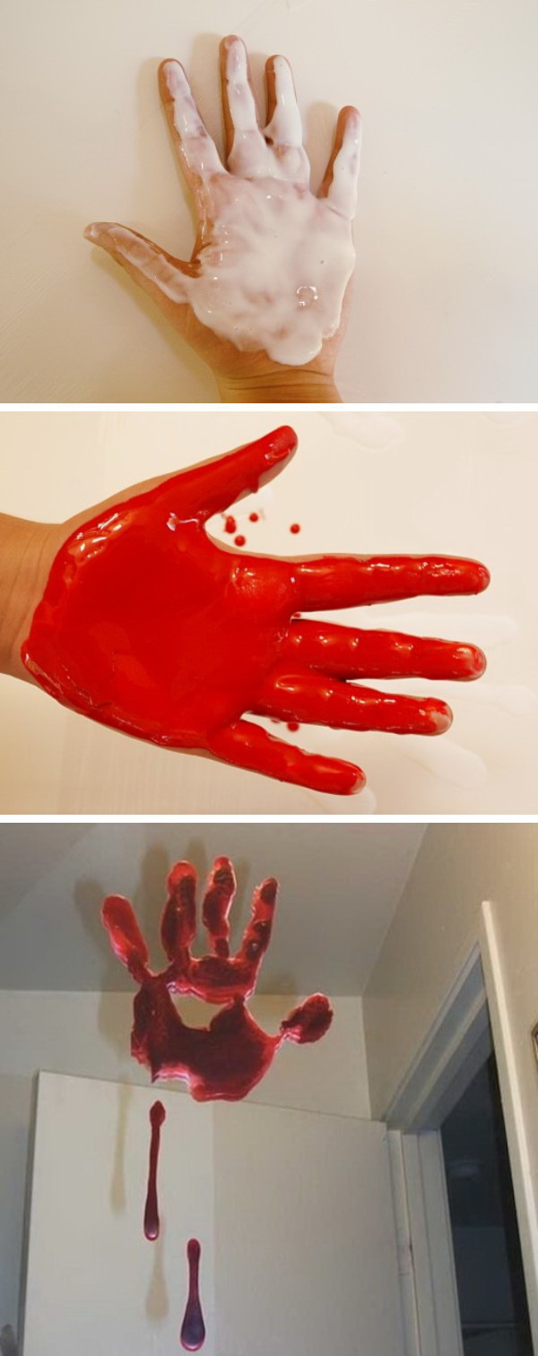 DIY Bloody Handprint Window Clings. The perfect accent to add spooky atmosphere to your home during the Halloween season.