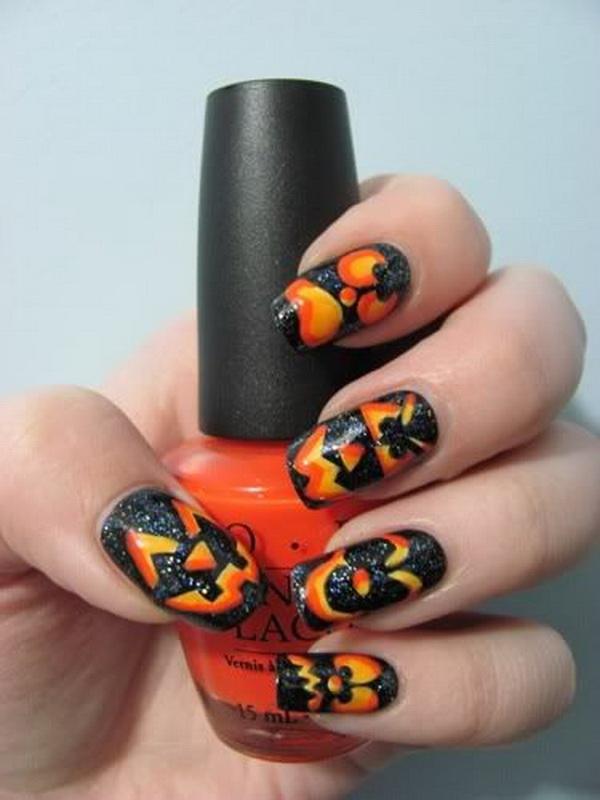 Cute Halloween Jack O Lantern Nail Design.