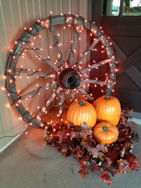 Lighted Wagon Wheels for Fall Decor. Get the autumn porch decor with pumpkin and lighted wagon wheels. It will be the highlight for a special corner on your front porch and add an interesting centerpiece for the front porch table.