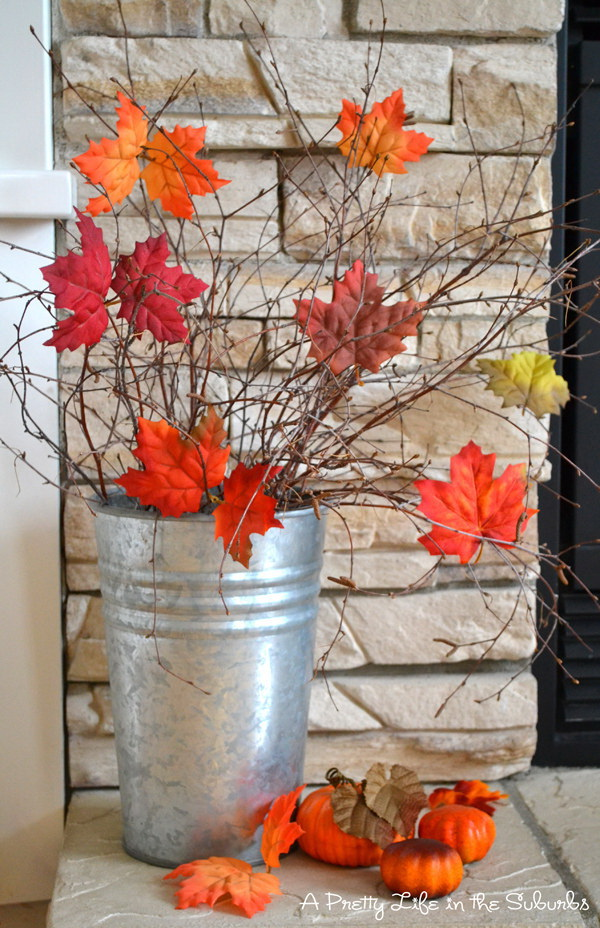 Fall Centerpiece Arrangements. Create a simple but festive arrangement with faux leaves and branches.
