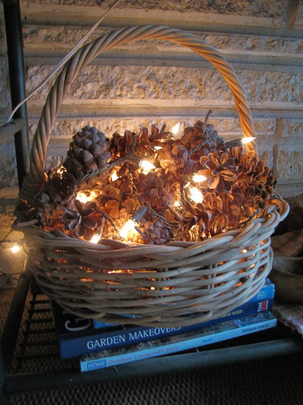 Rustic Basket Arrange for Fall Decoration. Nestle string lights between pinecones in a basket! One of the simpliest idea for rustic fall or Christmas decoration.