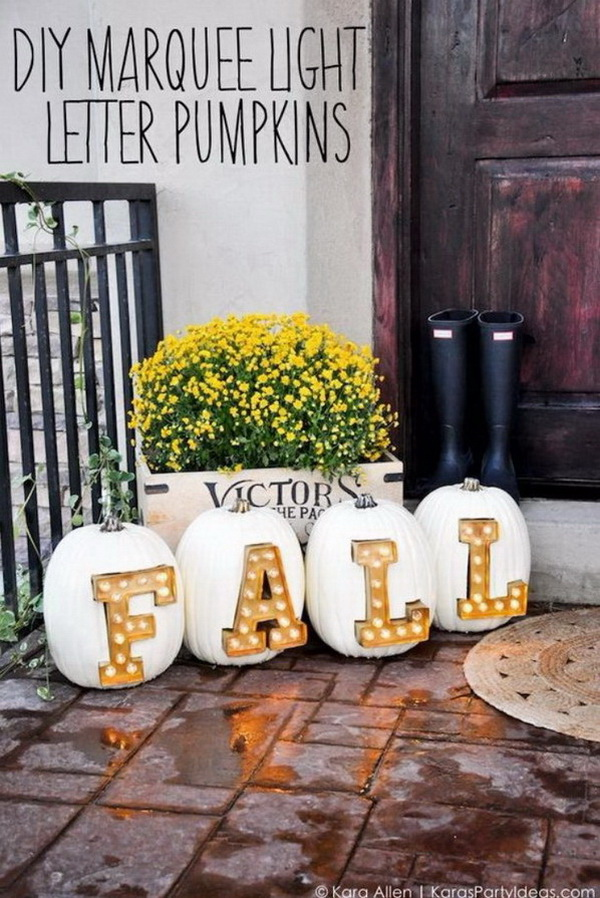 DIY Marquee Light Pumpkins. Carve the pumpkins and decorate with big bold Marquee light letters. Looks perfect for your front porch to display and create a touch of country charm and an inviting atmosphere!