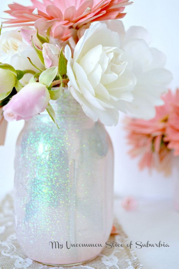 DIY Mason Glitter Jars. These DIY mason glitter jars are a perfect a flower centrepiece or pen holder for any special event!