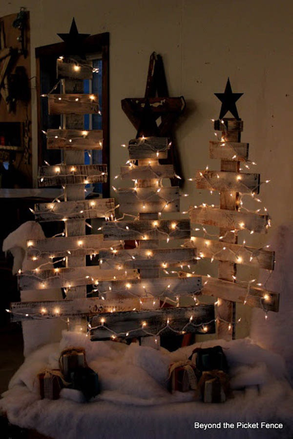 DIY Wood Christmas Tree. Make this Christmas tree from old white picket fences and decorate it with the white or yellow Christmas lights. It is great for your porch or bedroom decoration this Christmas.