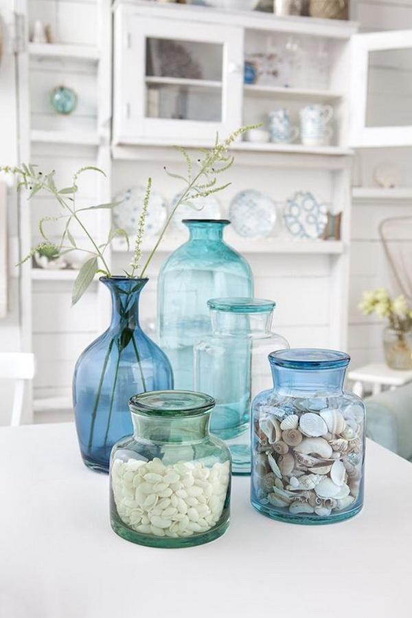 Coastal Style Glass Centerpiece. Fill the glass bottles with beach finds and group together for a great look for home decoration!