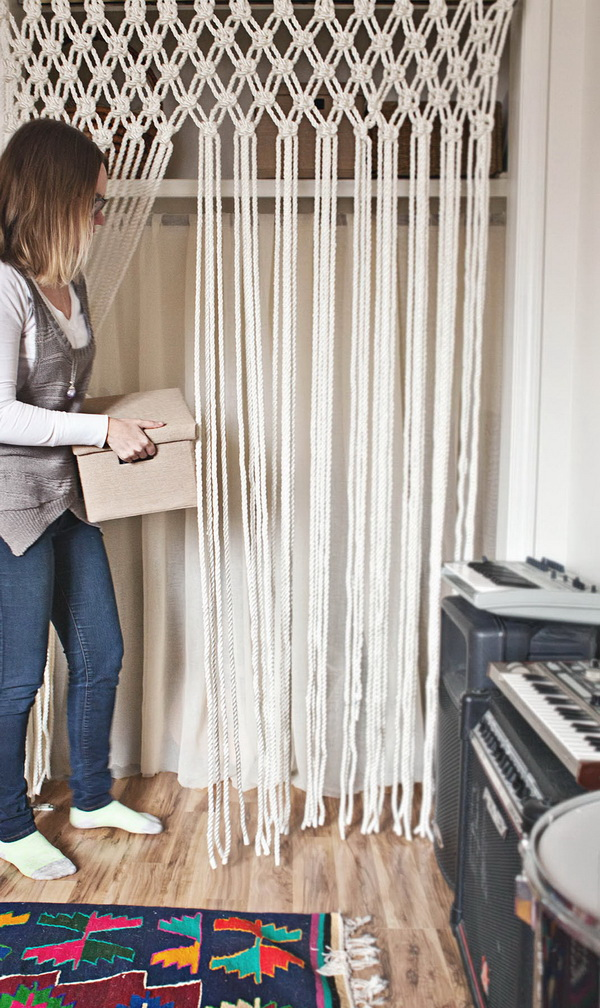 DIY Macrame Curtain. Add a touch of bohemian chic to your decor with these DIY macrame curtains! They're a great addition to hallways, bedroom...