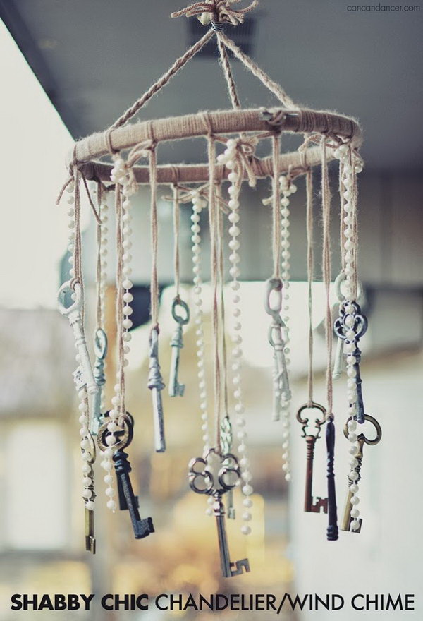 Handmade shabby chic chandelier made with old keys, jute and beads.