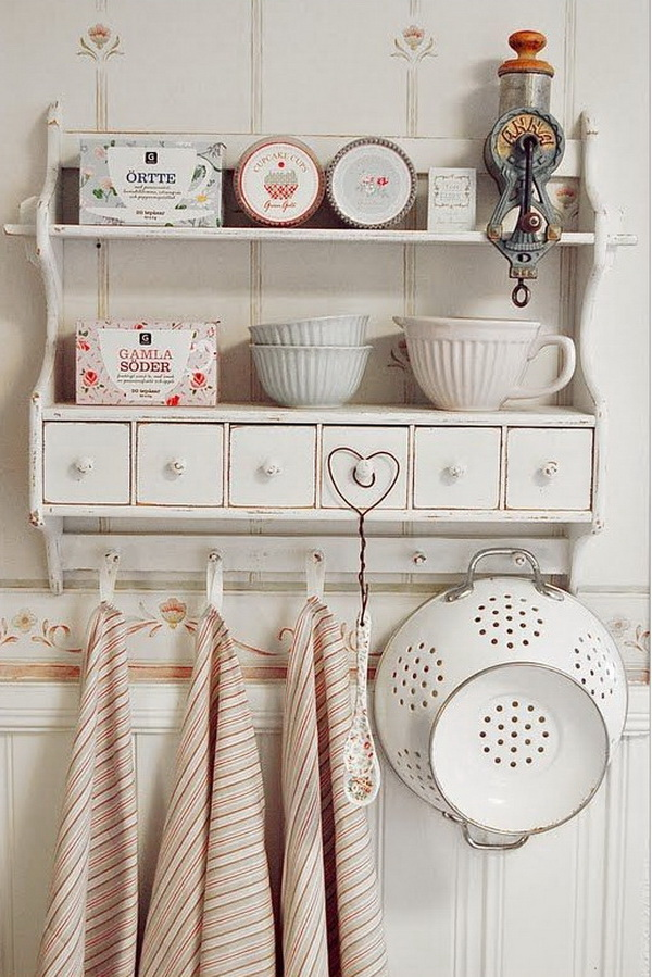 Shabby chic country style kitchen shelving.