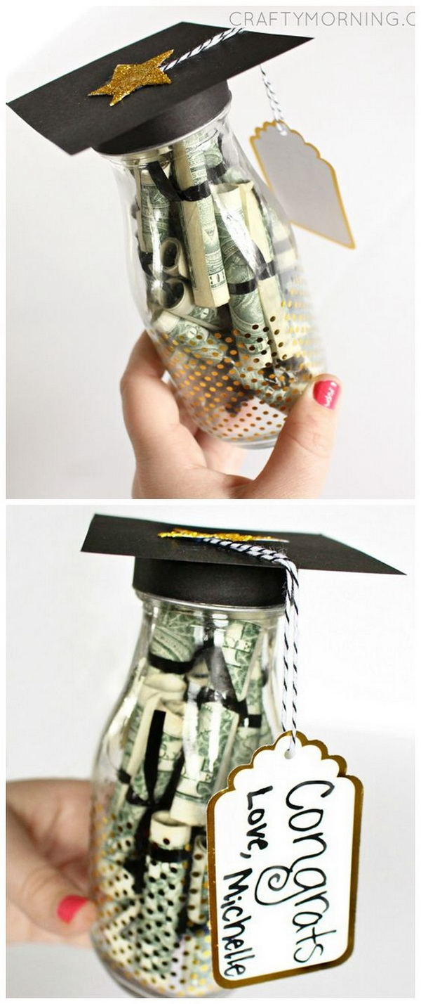 Graduation Glass Bottle Gift. Stuff the rolled dollar bills inside a glass bottle or jar. Top it with a mini DIY graduation cap and a star shape glitter topper. Great gradution gift that you can make yourself!