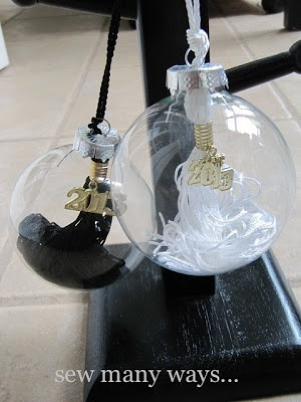 Graduation Tassel Ornaments. Make a graduation tassel ornament using clear glass Christmas ornaments. It makes the perfect gift idea and a creative graduation decor craft!