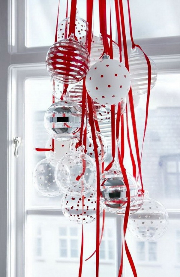 Hang Ornaments for Christmas Window Decorations. Do not forget the windows for holiday decoration.