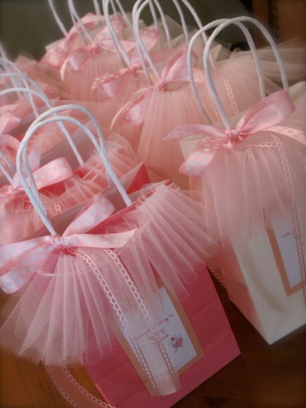 Princess Skirt Bags. If you are planning a princess birthday party, these fun princess-inspired bags pink tulle skirt paper bags are great for wrapping the gifts or favors. All you need is some tulle to get started!